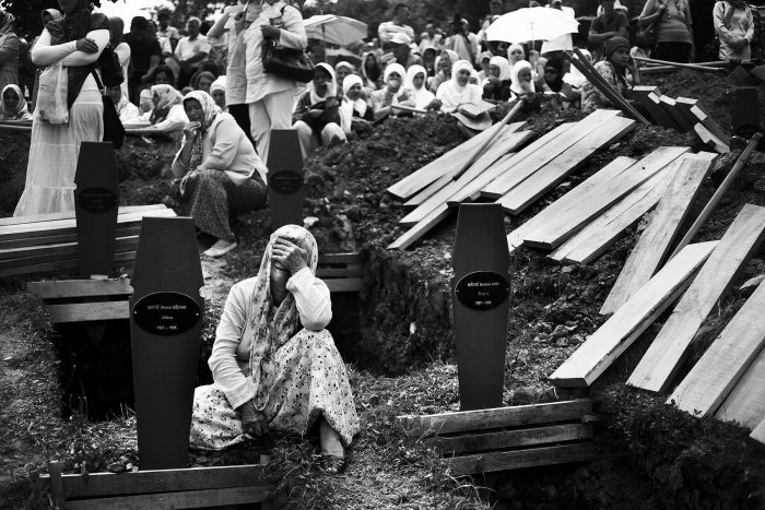 A woman weeps for her family members that are being buried at the memorial. This year, over 50,000 people came to the ceremony to pay their respects and bury their loved ones. When women were separated from their husbands, fathers, and sons during the war in 1995, they were told they would be prisoners of war but were taken to neighboring towns and murdered.