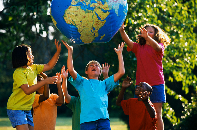 Children Playing with Globe --- Image by © Ariel Skelley/CORBIS